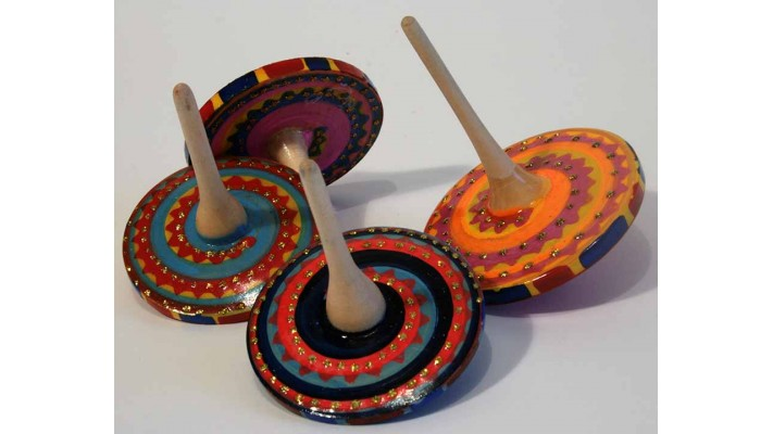 Multicolored wooden spinning top
